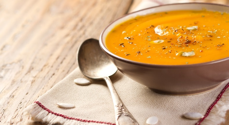 Cruched  pumpkin soup in bowl on  old wooden table