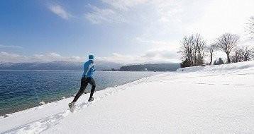 Germany, Mature man jogging by Walchensee Lake