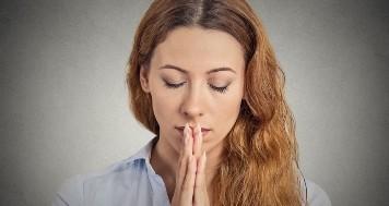 Portrait peaceful woman praying