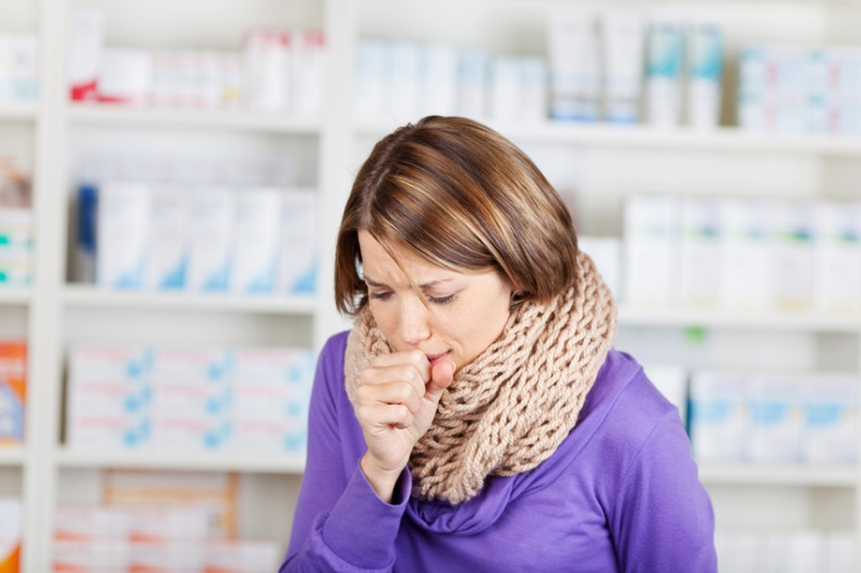 Sick woman in the pharmacy