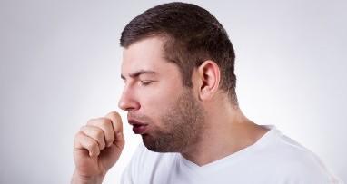 Sick man having a cough
