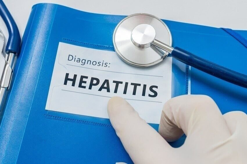 Blue folder with Hepatitis C diagnosis.