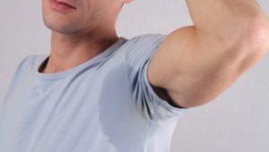 Sport man armpit sweating. Transpiration stain. Hyperhidrosis concept