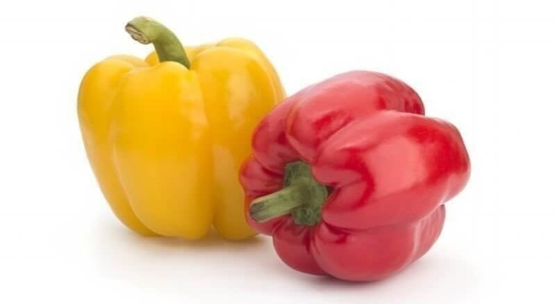 Yellow, red sweet pepper on a white background