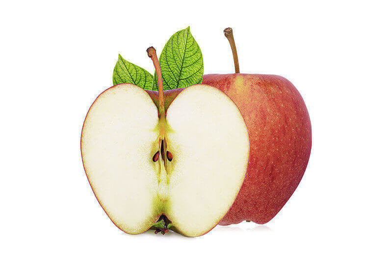 whole and half of fresh gala apple with green leaves isloated on white background
