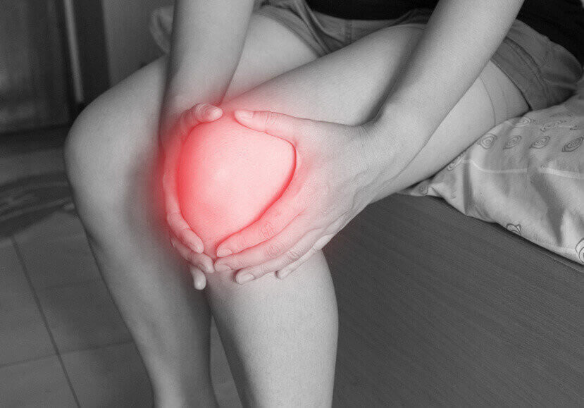 women has inflammation and swelling cause a pain the sore knee, sport physical injuries when working out.