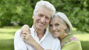 Loving mature couple  in a summer park