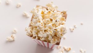 Bucket of popcorn on white background