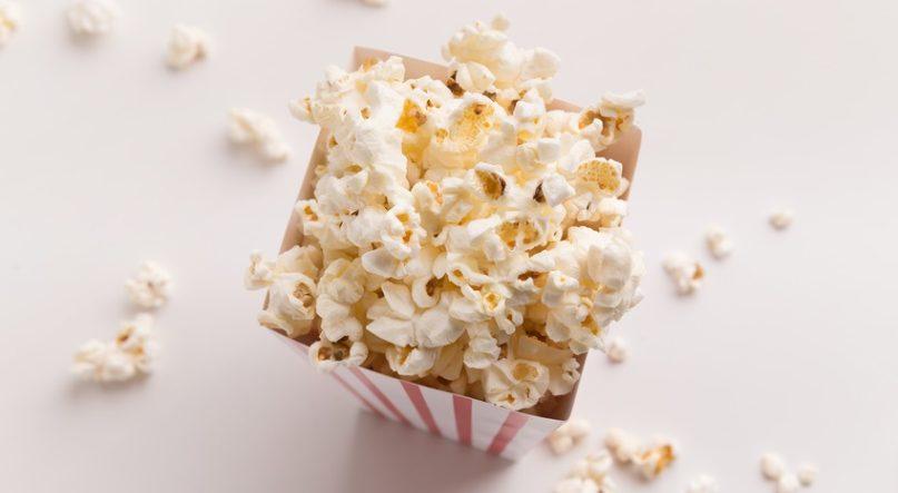 Bucket of popcorn on white background